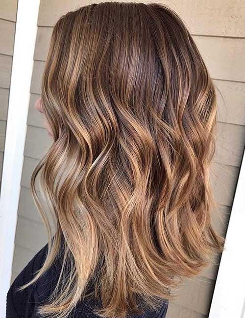 Dark brown hair to light brown hair