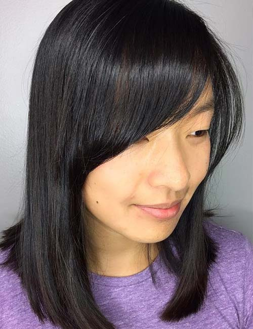 11. Smooth Side-Swept Bangs On Straight Hair