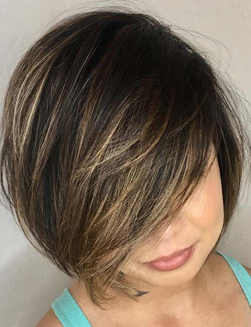 12. Heavy Layered And Highlighted Side-Swept Bangs