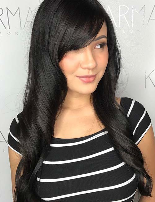 13. Smooth Side-Swept Bangs On Long Hair