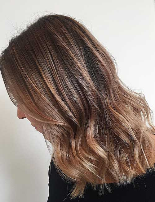 15. Light Brown Balayage With Auburn Undertones