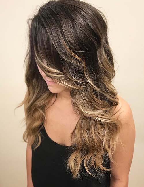 17. Long Sweeping Side-Swept Bangs On A Balayage
