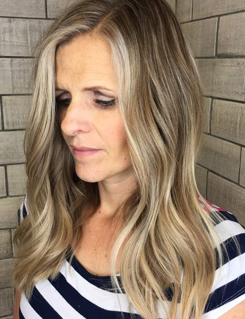 3. Ash Blonde Highlights On Long Wavy Hair