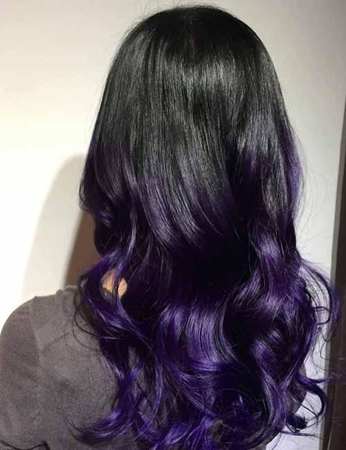 dark brown hair with purple underneath brown hairs