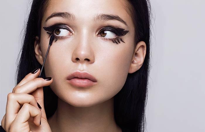 3. Create Eyeliner Flicks With A Thread