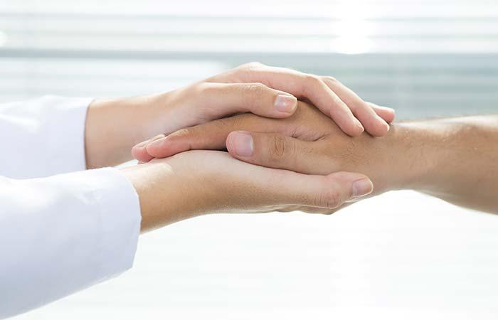 10. Palm Sandwich Handshake