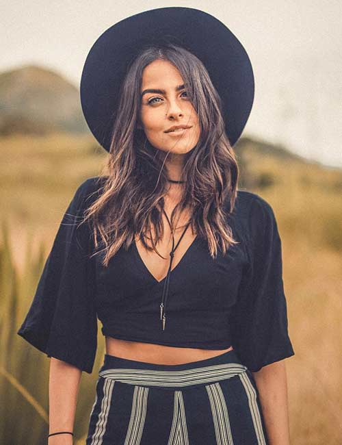 Best Coachella outfit - Strip Palazzos, Crop Top, And Hat