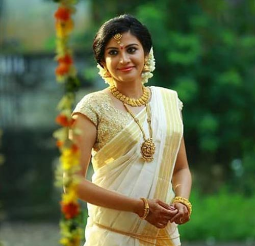 Kerala Saree and a Golden Blouse