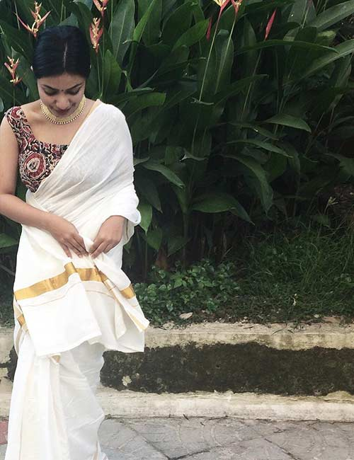 Best Kerala Saree Blouse Designs - Kerala Saree And Sleeveless Kalamkari Blouse