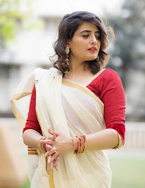 Kerala Saree with a plain red blouse