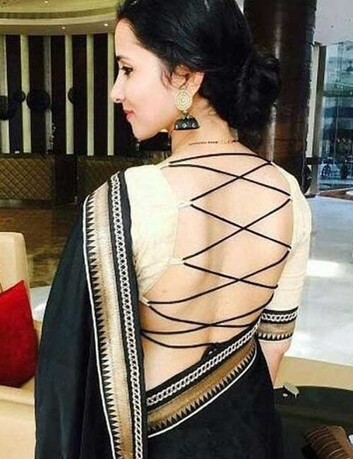 Plain Black Saree With A Backless Blouse