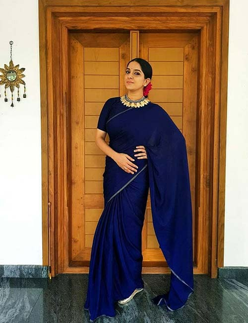 Plain Blue Saree With A Boat Neck Blouse