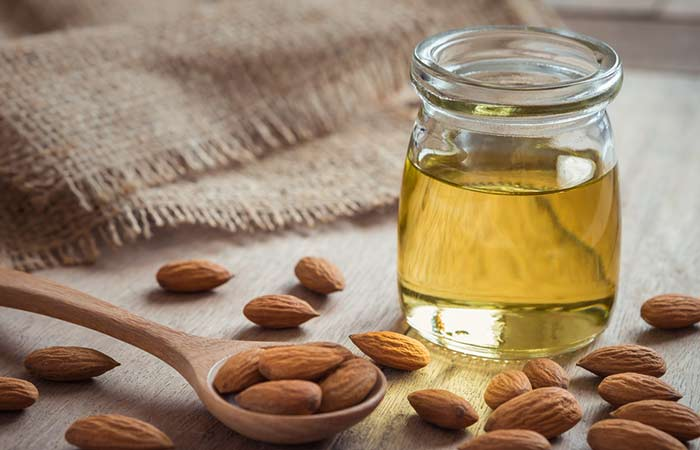 10. Almond oil is both a good remedy to treat dandruff and increase the length of your hair because it is rich in vitamin E. Hot massage with this oil can help reduce dandruff. You must do it at least once a week. You can also mix it with olive oil to double the benefits of it for your hair! </p> <h2>  11. Copper </h2> <div id=