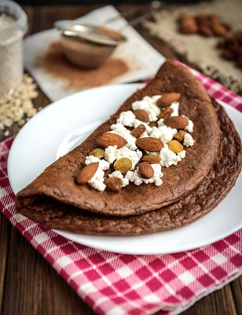4. Chocolate Oat Pancake With Ricotta And Nuts
