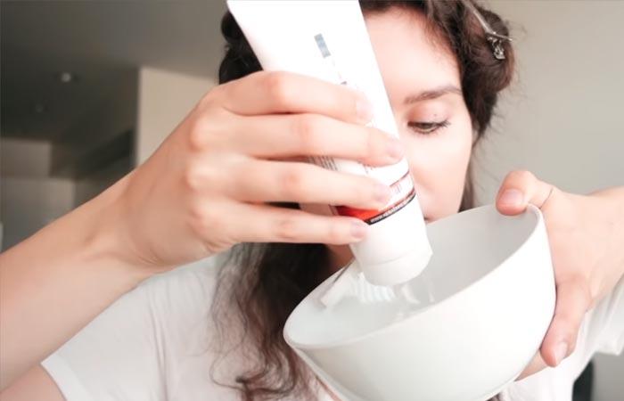 Brazilian keratin treatment solution into a plastic bowl