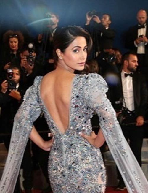 She walks on the red carpet in Cannes as a wild