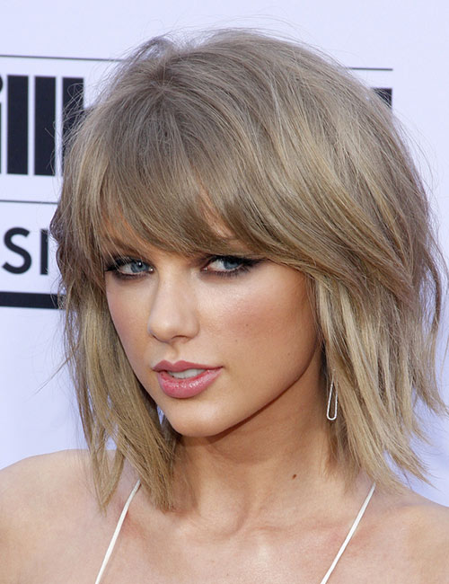 14. Heavy Wispy Bangs