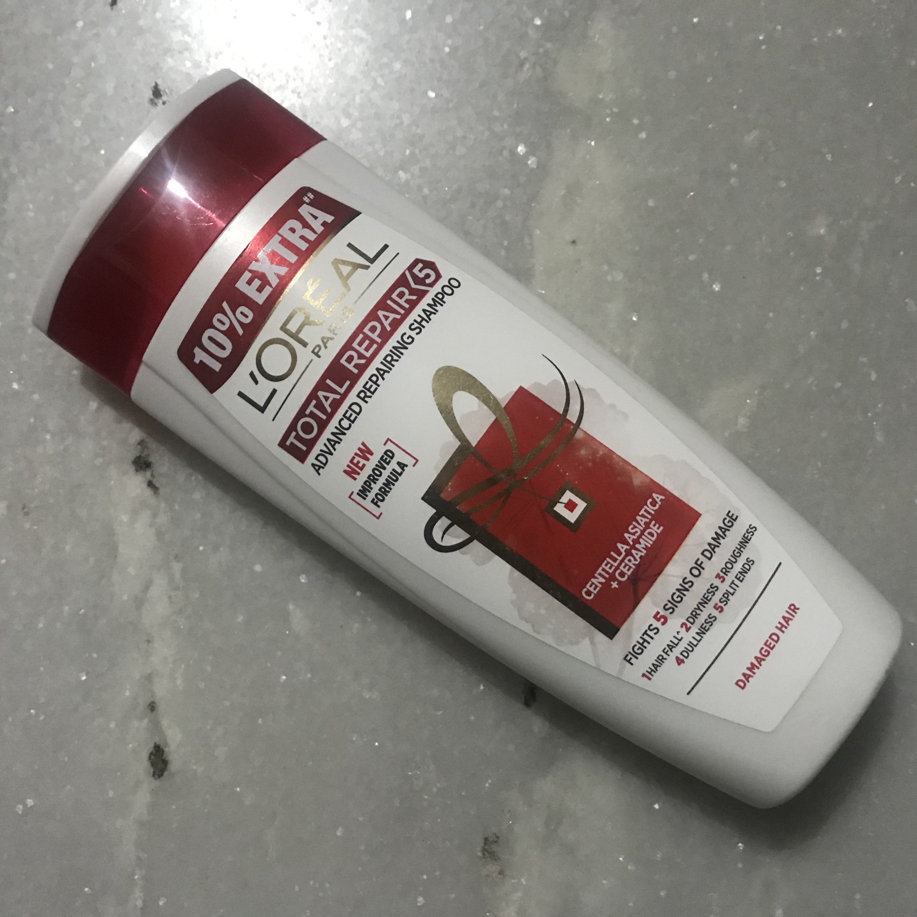 L'Oreal Paris Total Repair 5 Advanced Repairing Shampoo-Nothing great other than the smell !-By kiranbir_