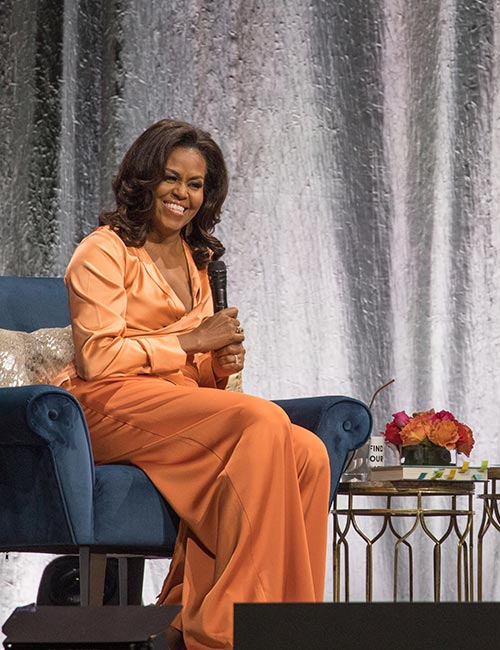 7. Michelle Obama In Satin Orange Blouse And Pants