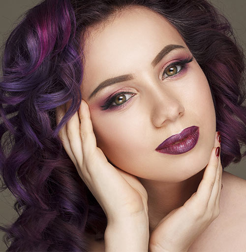 Shutterstock </p> </div> <p>  Leave your roots dark and add light and dark purple lights all over your hair. The dark roots will extend your face, and the light and dark accents will highlight the color of your eyes and soften the shape of the face. Be sure to match the highlights of the skin to get the best of them. Wild Purple </h3> <div id=