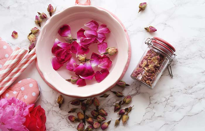 Rub the skin with rose water
