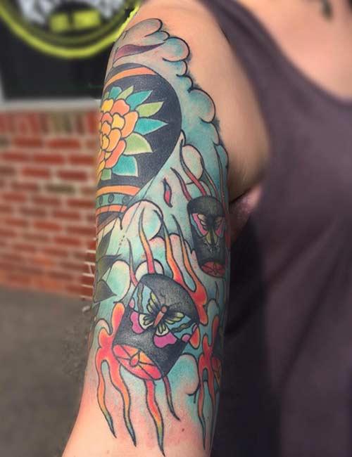 21. Lantern On Tree With Butterflies Tattoo