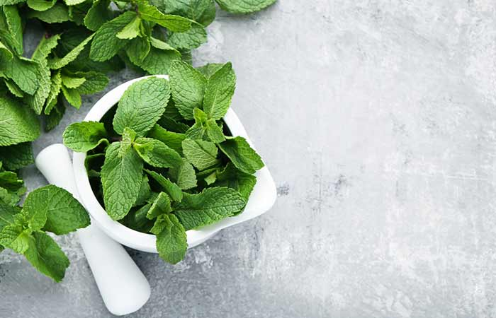 Green coffee with mint leaves