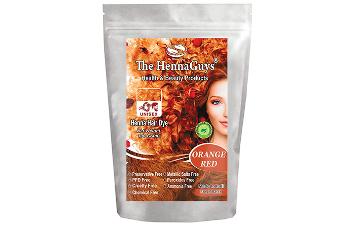 Orange red henna hair dye