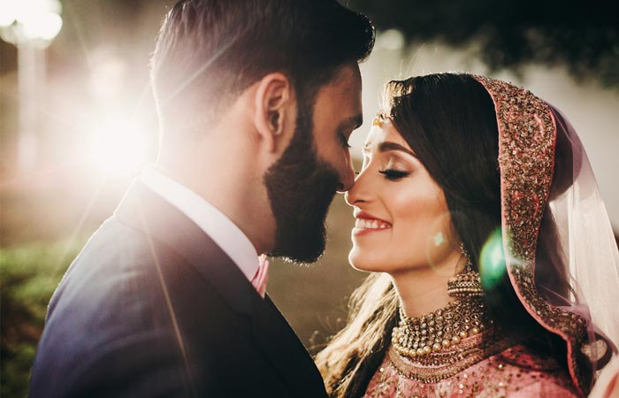 handsome-bearded-indian-groom-kisses-bride