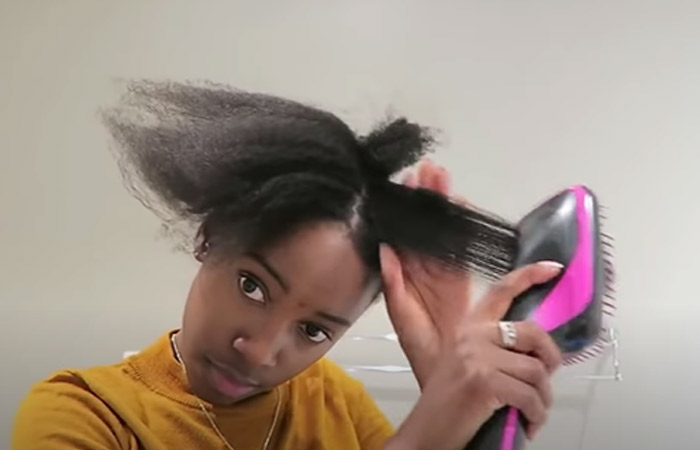 Step 7 Blow dry a small section of your hair on a medium to high heat setting. Use a brush blow dryer with a brush attachment to make it easy. You can also use a traditional blow dryer and comb.