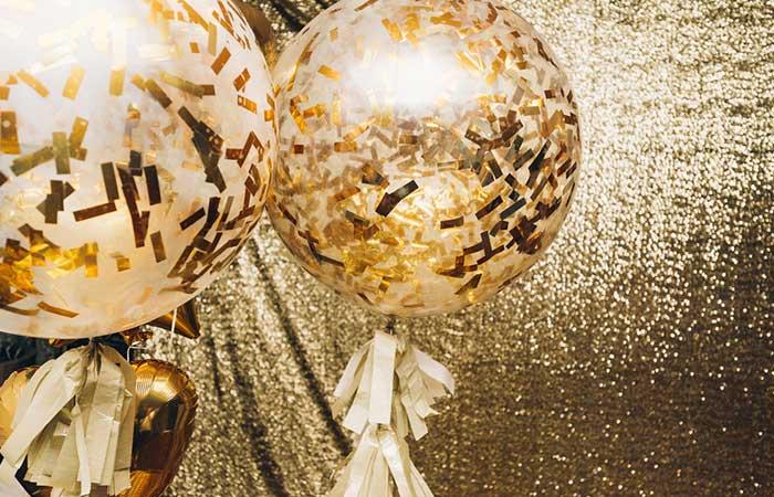 Add Confetti Into Some Balloons For Decor