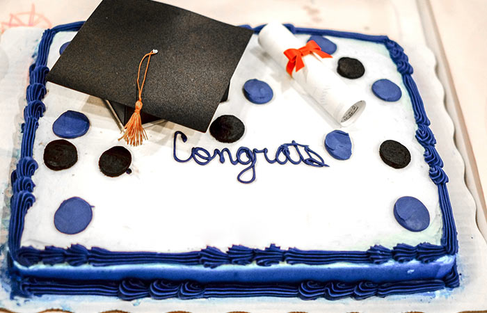Blue And White Cake With Graduation Cap
