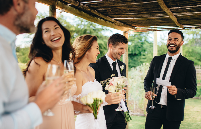 best-man-giving-speech-newlywed-couple