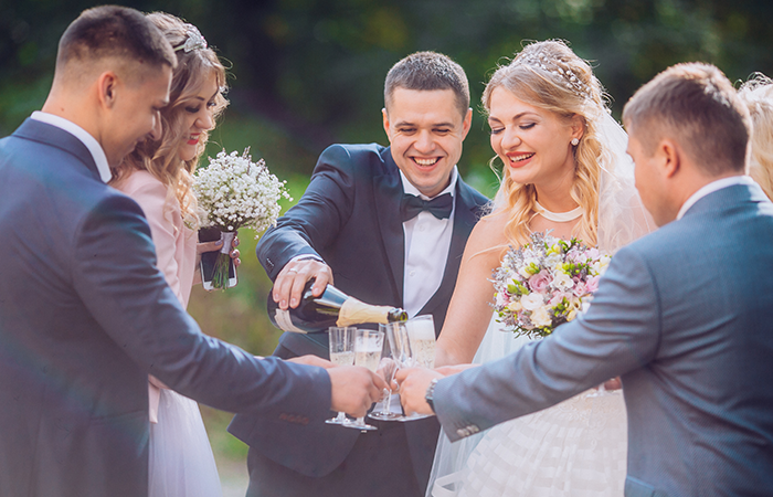 bride-groom-happy-groomsmen-bridesmaids-having