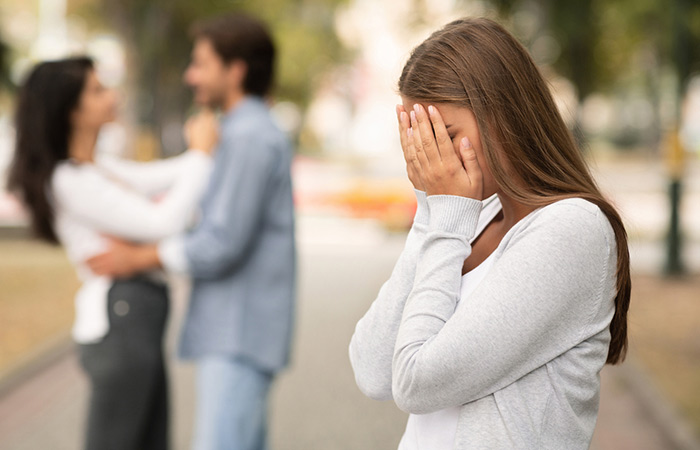 upset-woman-crying-seeing-her-boyfriend-with-other-girl