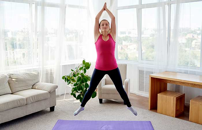 young-fitness-woman-doing-jumping-jacks-16