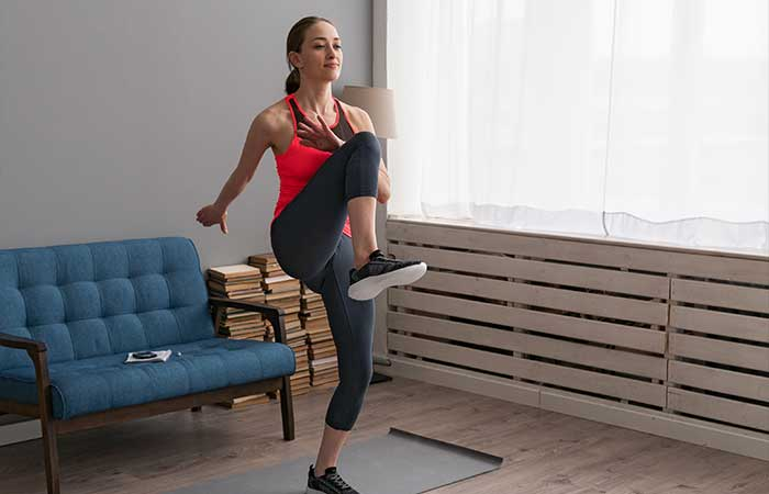 young-woman-doing-fitness-training-home